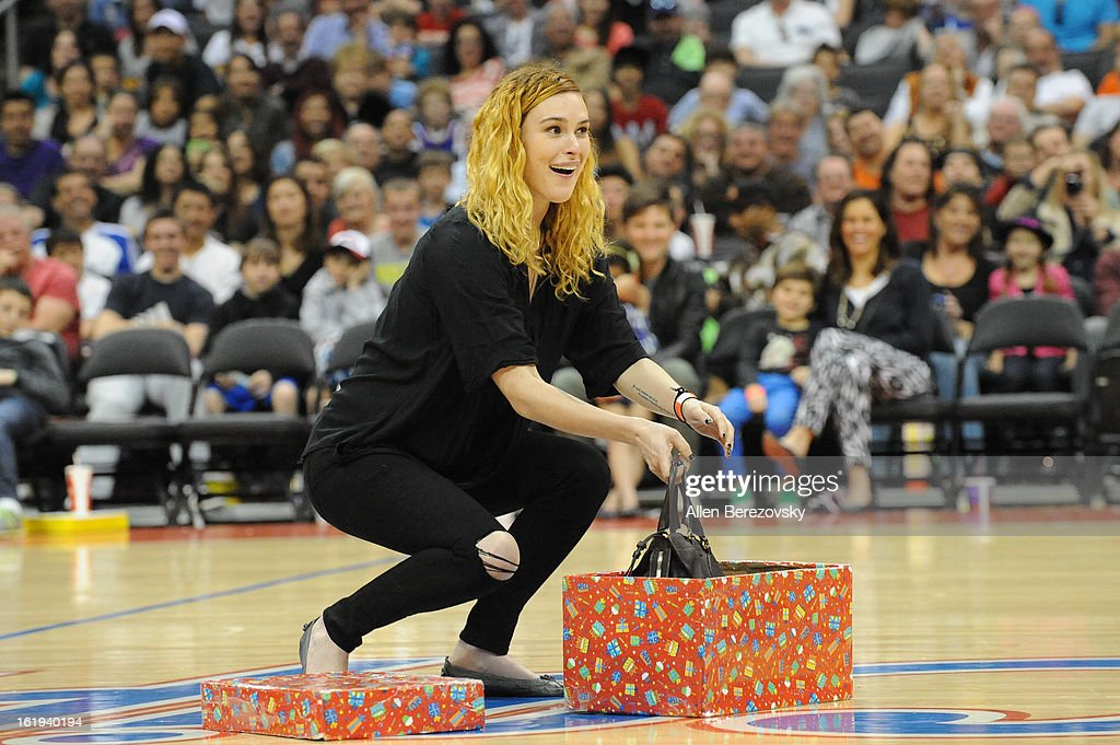 Actress <a gi-track='captionPersonalityLinkClicked' href=/galleries/search?phrase=Rumer+Willis&family=editorial&specificpeople=617003 ng-click='$event.stopPropagation()'>Rumer Willis</a> attends the Harlem Globetrotters 'You Write The Rules' 2013 tour game at Staples Center on February 17, 2013 in Los Angeles, California.