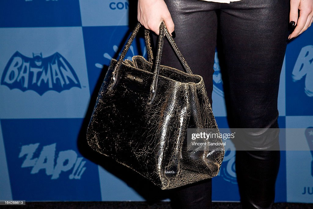 Actress Rumer Willis (purse detail) attends the launch of the Batman classic TV series licensing program at Meltdown Comics and Collectibles on March 21, 2013 in Los Angeles, California.