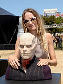 Actress Ruta Gedmintas poses with A wax figure of Quinlan from 'The Strain' at FXhibition during ComicCon International 2016 at Hilton Bayfront on...