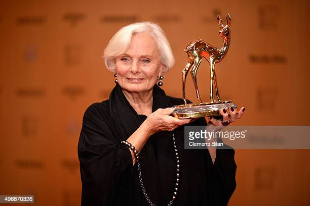 Actress Ruth Maria Kubitschek is posing with the award she accepted on behalf of producer Wolfgang Rademann at the Bambi Awards 2015 winners board at...