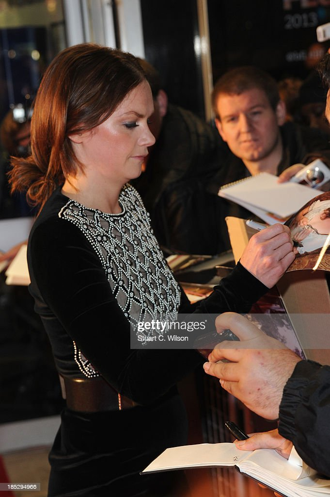 Actress Ruth Wilson signs autographs as she attends a screening of 'Locke' during the 57th BFI London Film Festival at Odeon West End on October 18, 2013 in London, England.