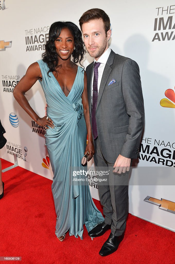 Actress Rutina Wesley (L) and Actor Jacob Fishel arrive at the 44th NAACP Image Awards held at The Shrine Auditorium on February 1, 2013 in Los Angeles, California.