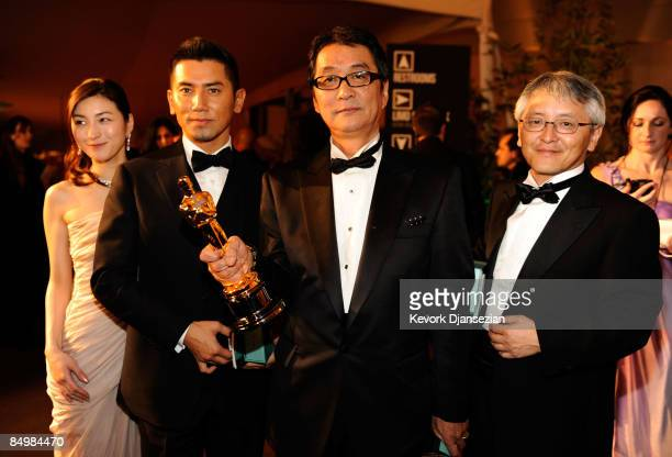 Actress Ryoko Hirosue actor Masahiro Motoki director Yojiro Takita and producer Ichiro Nobukuni attend the 81st Annual Academy Awards Governor's Ball...