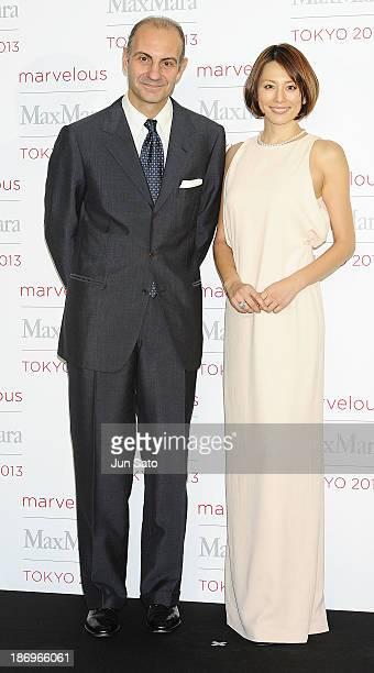 Actress Ryoko Yonekura and Luigi Maramotti of Charman of Max Mara attend a photocall of Marvelous Max Mara Tokyo 2013 at Ryogoku Kokugikan on...