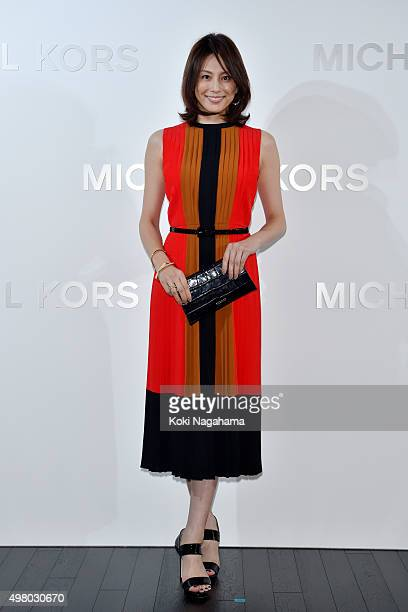 Actress Ryoko Yonekura attends the opening event for the Michael Kors Ginza Flagship Store on November 20 2015 in Tokyo Japan