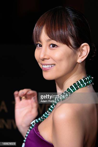 Actress Ryoko Yonekura poses for photographers during the photo call at the BVLGARI Ginza Tower fifth anniversary on November 9 2012 in Tokyo Japan