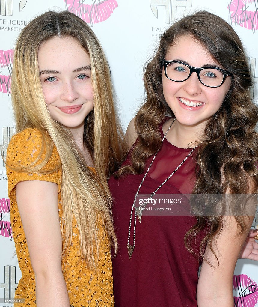 Actress Sabrina Carpenter (L) and sister Sarah attend the Bellacures Nail Salon celebrity event at the Bellacures Nail Salon on August 26, 2013 in Studio City, California.
