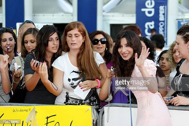 Actress Sabrina Impacciatore poses with the fans during Giffoni Experience 2010 on July 28 2010 in Giffoni Valle Piana Italy