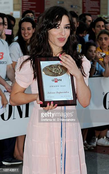 Actress Sabrina Impacciatore poses with the Giffoni Award during the Giffoni Experience 2010 on July 28 2010 in Giffoni Valle Piana Italy