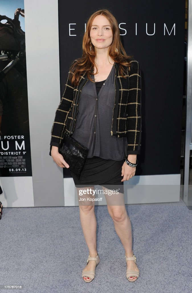 Actress Saffron Burrows arrives at the Los Angeles Premiere 'Elysium' at Regency Village Theatre on August 7, 2013 in Westwood, California.