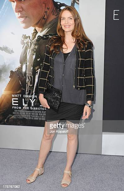Actress Saffron Burrows arrives at the Los Angeles Premiere 'Elysium' at Regency Village Theatre on August 7 2013 in Westwood California