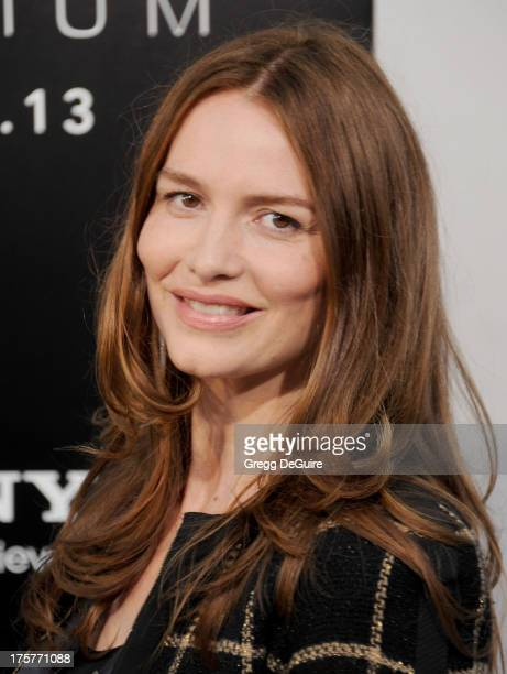 Actress Saffron Burrows arrives at the Los Angeles premiere of 'Elysium' at Regency Village Theatre on August 7 2013 in Westwood California