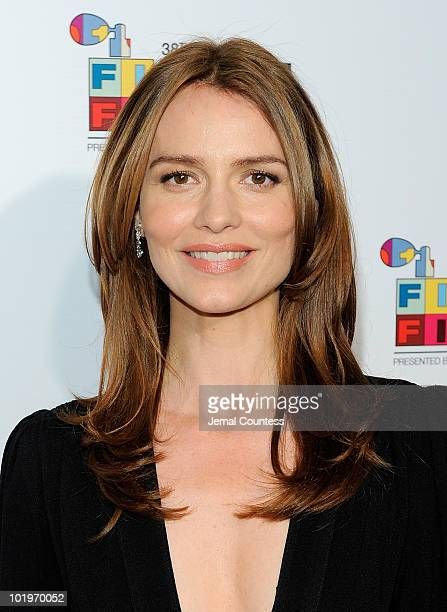 Actress Saffron Burrows poses for a photo on the red carpet at the 2010 Fifi Awards at the New York State Armory on June 10 2010 in New York City