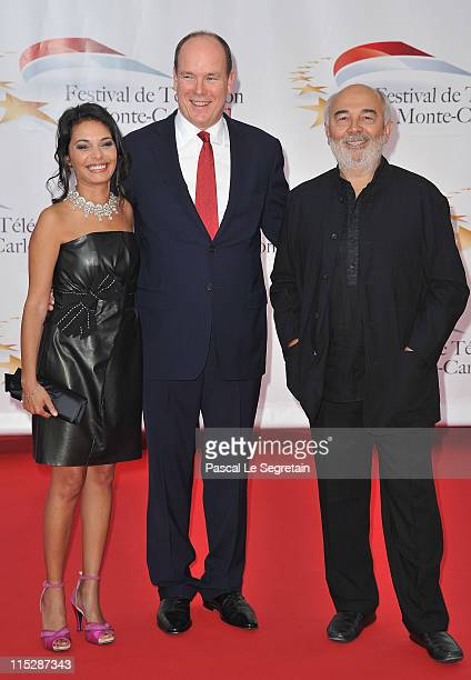 Actress Saida Jawad Prince Albert II of Monaco and actor Gerard Jugnot pose as they arrive for the opening night of the 2011 Monte Carlo Television...
