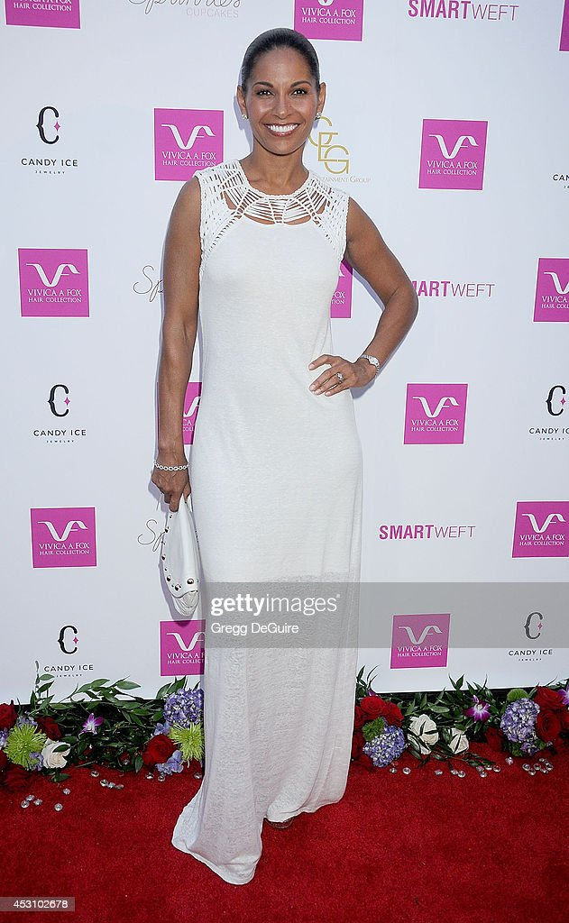 Actress <a gi-track='captionPersonalityLinkClicked' href=/galleries/search?phrase=Salli+Richardson&family=editorial&specificpeople=2717812 ng-click='$event.stopPropagation()'>Salli Richardson</a> arrives at the Vivica A. Fox 50th Birthday party at Philippe Chow on August 2, 2014 in Beverly Hills, California.