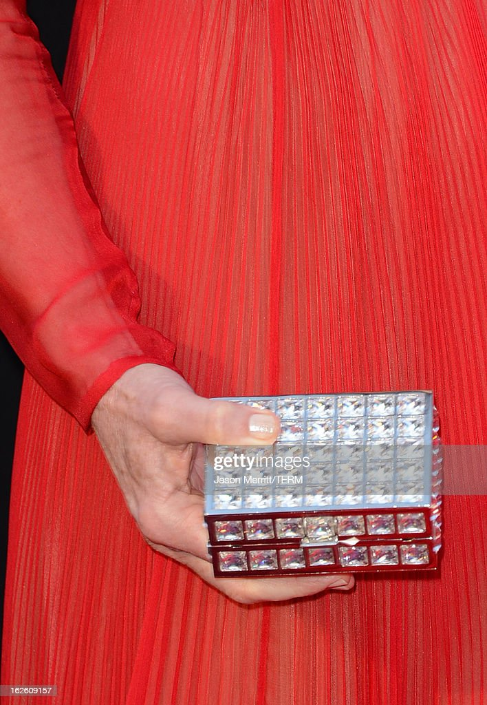 Actress Sally Field (clutch detail) arrives at the Oscars at Hollywood & Highland Center on February 24, 2013 in Hollywood, California.