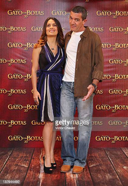 Actress Salma Hayek and actor Antonio Banderas attend a photocall for 'Puss In Boots' at the Four Seasons Hotel on November 15 2011 in Mexico City...
