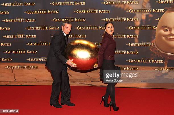Actress Salma Hayek and actor Antonio Banderas attend the 'Puss In Boots' Premiere at CineStar on November 22 2011 in Berlin Germany