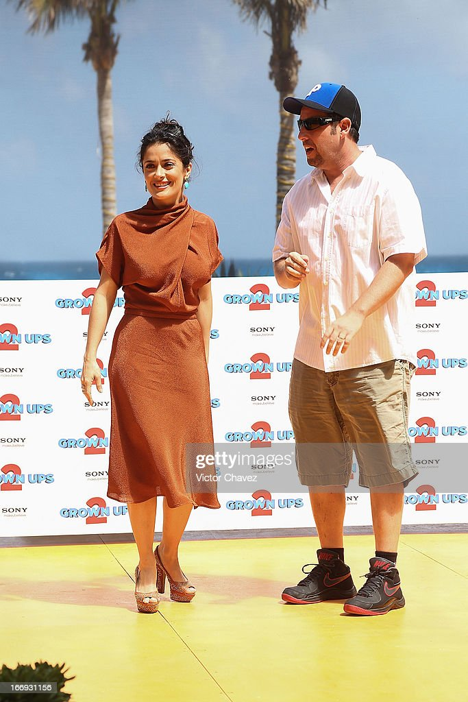 Actress Salma Hayek and Adam Sandler attend the 'Grown Ups 2' photocall during The 5th Annual Summer Of Sony on April 18, 2013 in Cancun, Mexico.