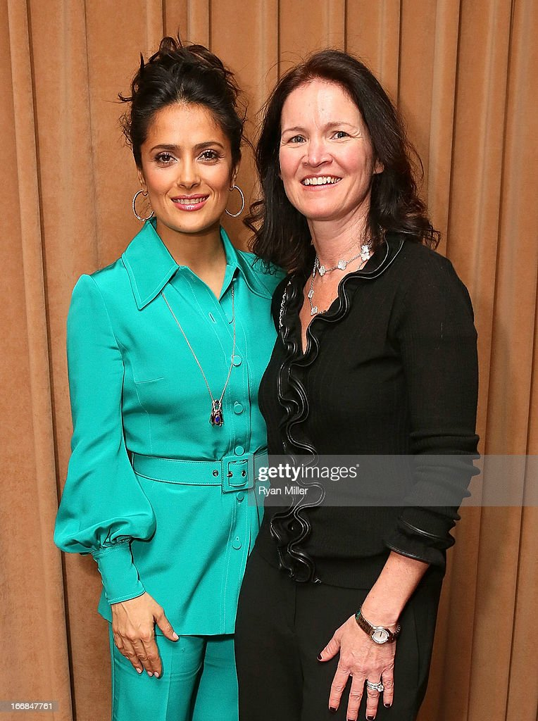 Actress <a gi-track='captionPersonalityLinkClicked' href=/galleries/search?phrase=Salma+Hayek&family=editorial&specificpeople=201844 ng-click='$event.stopPropagation()'>Salma Hayek</a> (L) and CEO Regal Entertainment, Amy Miles pose backstage prior to the Sony Pictures Entertainment Invites You to an Exclusive Product Presentation Highlighting its 2013 Films at Caesars Palace during CinemaCon, the official convention of the National Association of Theatre Owners on April 17, 2013 in Las Vegas, Nevada.