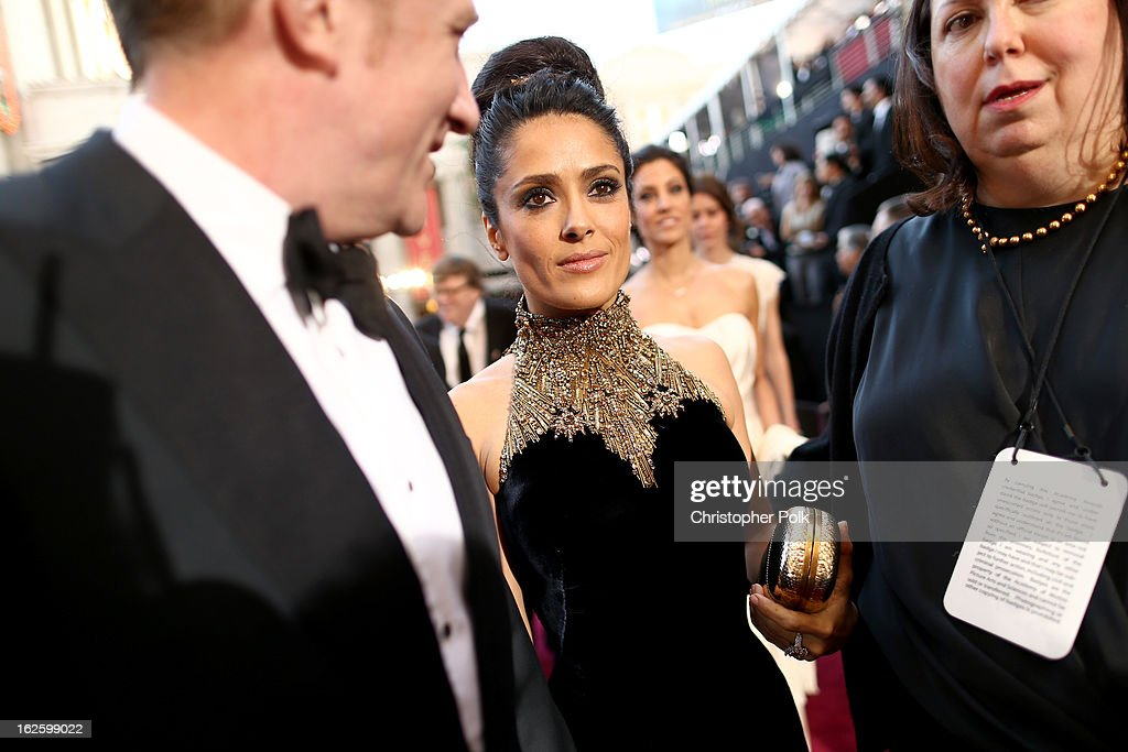 Actress <a gi-track='captionPersonalityLinkClicked' href=/galleries/search?phrase=Salma+Hayek&family=editorial&specificpeople=201844 ng-click='$event.stopPropagation()'>Salma Hayek</a> (R) and François-Henri Pinault arrive at the Oscars held at Hollywood & Highland Center on February 24, 2013 in Hollywood, California.