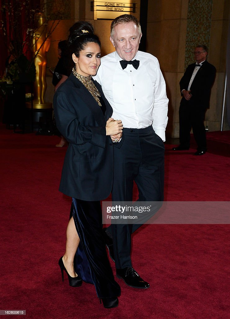 Actress Salma Hayek and François-Henri Pinault depart the Oscars at Hollywood & Highland Center on February 24, 2013 in Hollywood, California.