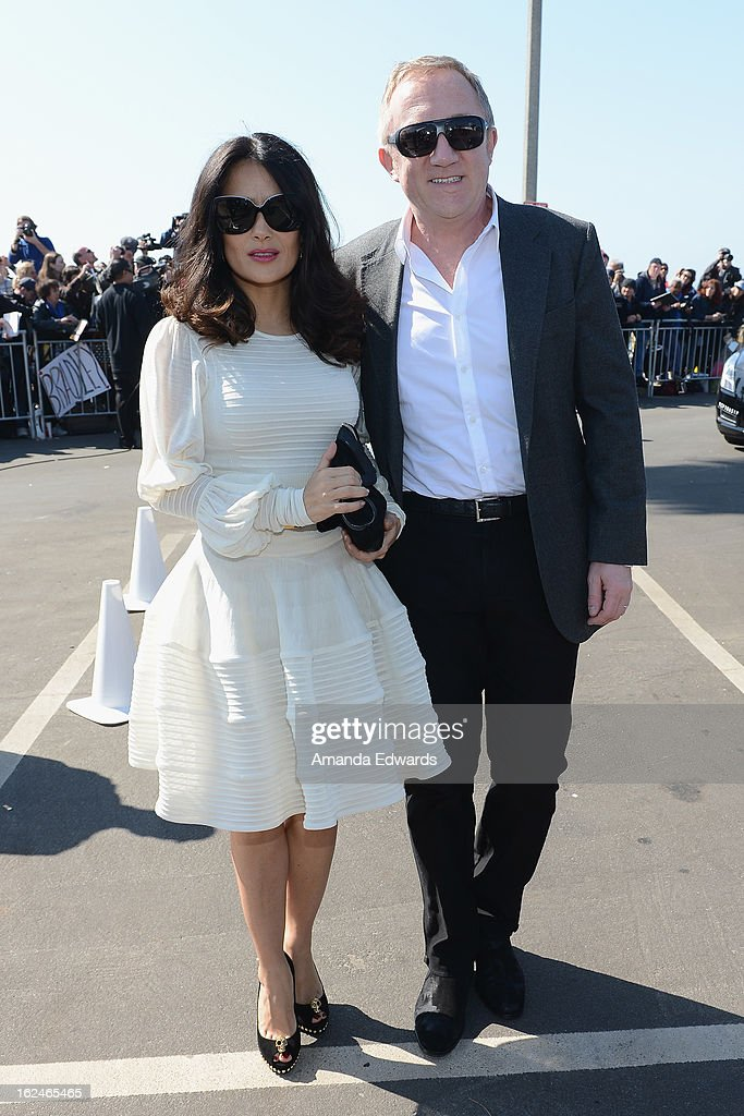 Actress <a gi-track='captionPersonalityLinkClicked' href=/galleries/search?phrase=Salma+Hayek&family=editorial&specificpeople=201844 ng-click='$event.stopPropagation()'>Salma Hayek</a> (R) and husband Francois-Henri Pinault attend the 2013 Film Independent Spirit Awards at Santa Monica Beach on February 23, 2013 in Santa Monica, California.