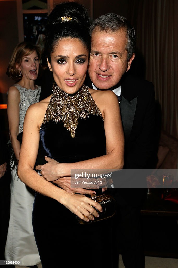 Actress Salma Hayek and photographer Mario Testino attend the 2013 Vanity Fair Oscar Party hosted by Graydon Carter at Sunset Tower on February 24, 2013 in West Hollywood, California.