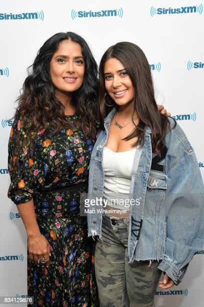 Actress Salma Hayek and SiriusXM host Symon pose for a photo as Salma Hayek visits the SiriusXM Studios on August 17 2017 in Los Angeles California