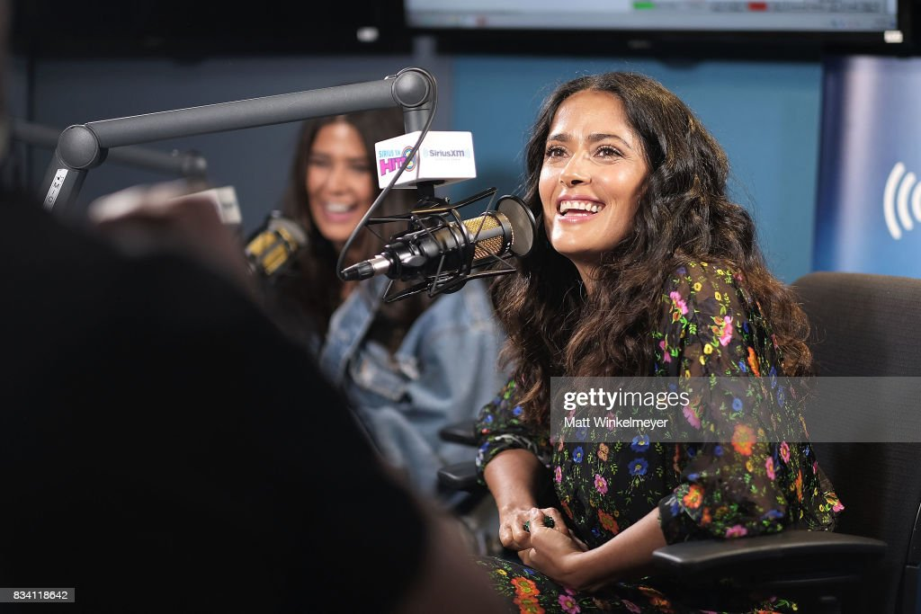 Actress Salma Hayek (R) and SiriusXM host Symon (L) speak on air as Salma Hayek visits the SiriusXM Studios on August 17, 2017 in Los Angeles, California.