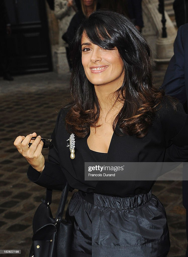 Actress Salma Hayek arrives at the Balmain Spring / Summer 2013 show as part of Paris Fashion Week at Grand Hotel Intercontinental on September 27, 2012 in Paris, France.