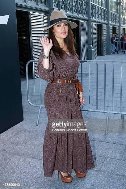 Actress Salma Hayek attends the Saint Laurent Menswear Spring/Summer 2016 show as part of Paris Fashion Week on June 28 2015 in Paris France