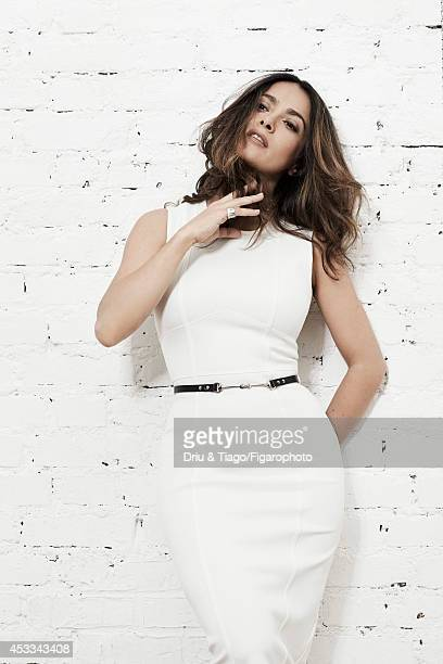 110093004 Actress Salma Hayek is photographed for Madame Figaro on June 6 2014 in Paris France Dress and belt Quatre Radiants ring Makeup Yves Saint...