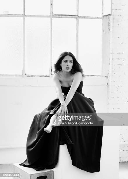 110093005 Actress Salma Hayek is photographed for Madame Figaro on June 6 2014 in Paris France Dress bracelet and rings Makeup Yves Saint Laurent...