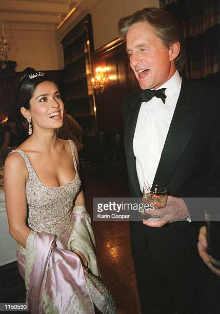 Actress Salma Hayek laughs with actor Michael Douglas during the Vanity Fair party following the annual White House Correspondents Association Dinner...
