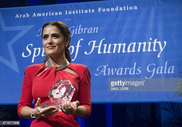 Actress Salma Hayek Pinault receives the Individual Achievement Award for her work at the Salma Hayek Foundation and Chime for Change as well as for...