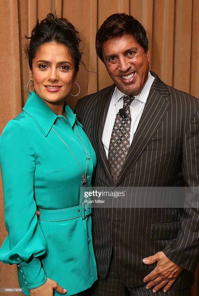 Actress <a gi-track='captionPersonalityLinkClicked' href=/galleries/search?phrase=Salma+Hayek&family=editorial&specificpeople=201844 ng-click='$event.stopPropagation()'>Salma Hayek</a> (L) poses with Sony Pictures' head of distribution, Rory Bruer backstage prior to the Sony Pictures Entertainment Invites You to an Exclusive Product Presentation Highlighting its 2013 Films at Caesars Palace during CinemaCon, the official convention of the National Association of Theatre Owners on April 17, 2013 in Las Vegas, Nevada.