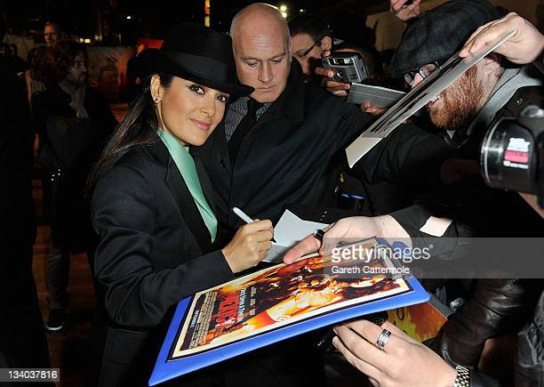 Actress Salma Hayek signs autographs as she attends the UK film premiere of 'Puss In Boots' at Empire Leicester Square on November 24 2011 in London...