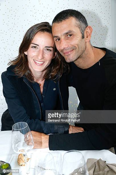 Actress Salome Stevenin and world record holder of apnea with 11 minutes and 35 seconds underwater Stephane Mifsud attend the Roland Garros French...