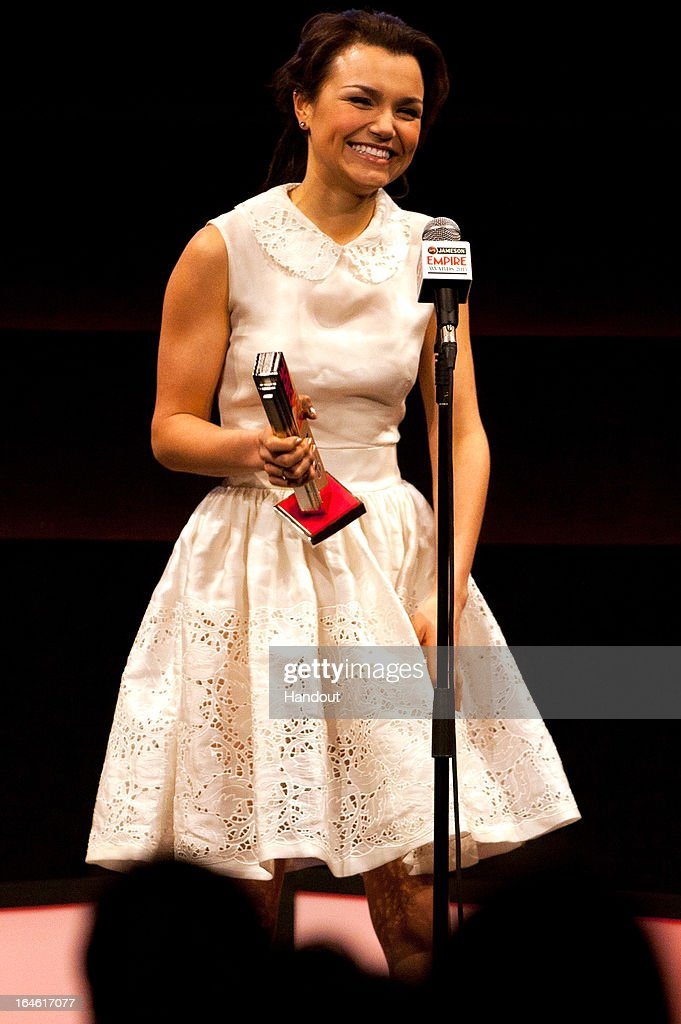 Actress <a gi-track='captionPersonalityLinkClicked' href=/galleries/search?phrase=Samantha+Barks&family=editorial&specificpeople=7061893 ng-click='$event.stopPropagation()'>Samantha Barks</a> wins the Best Female Newcomer award at the Jameson Empire Awards at Grosvenor House on March 24, 2013 in London, England. Renowned for being one of the most laid-back awards shows in the British movie calendar, the Jameson Empire Awards celebrate the film industry's success stories of the year with Empire Magazine readers voting for the winners. Visit empireonline.com/awards2013 for more information.