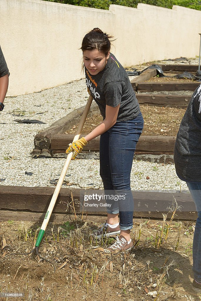 Actress Samantha from Nickelodeon's 'How to Rock' volunteers with students for a Big Help environmental project at New Horizon Elementary & Middle School on April 30, 2012 in Pasadena, California.