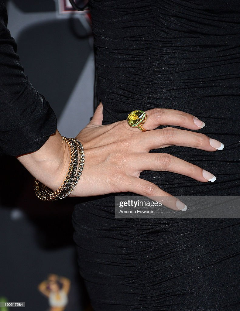 Actress Sammy Durrani (jewelry detail) arrives at the Los Angeles Premiere of 'The Devil's Dozen' at Mann's Chinese 6 Theatres on February 1, 2013 in Hollywood, California.