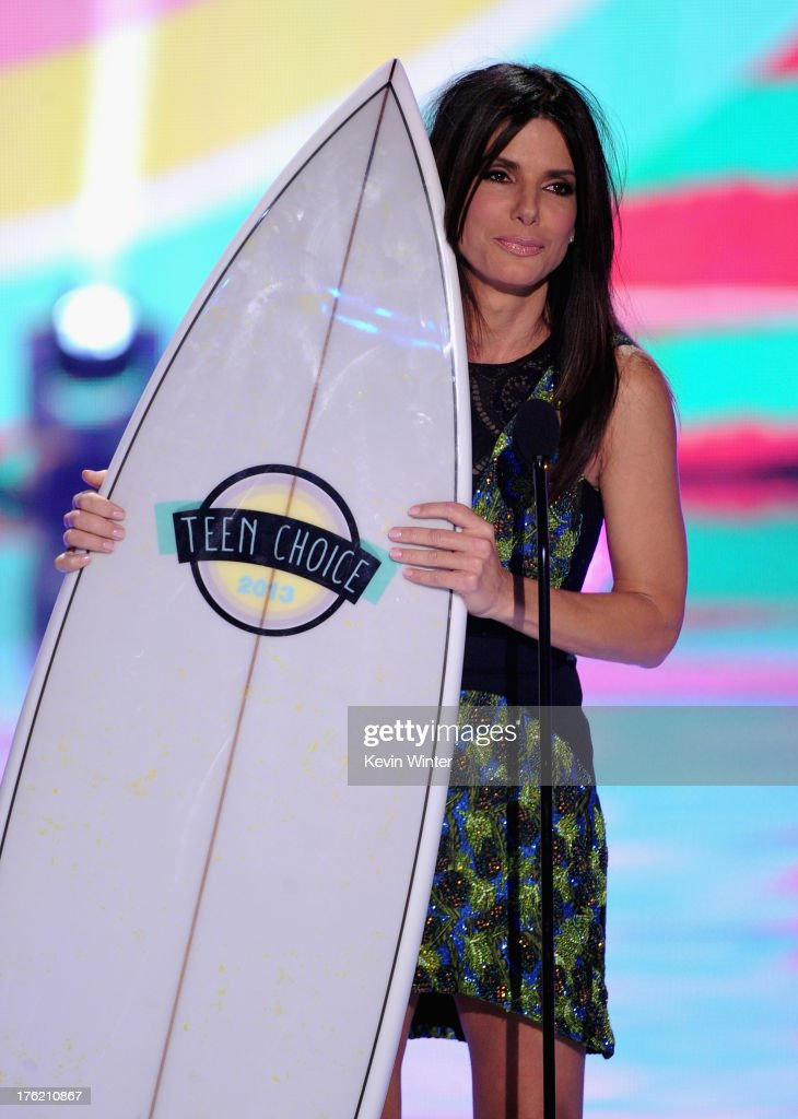 Actress Sandra Bullock accepts Choice Summer Movie Star: Female for 'The Heat' onstage during the Teen Choice Awards 2013 at Gibson Amphitheatre on August 11, 2013 in Universal City, California.