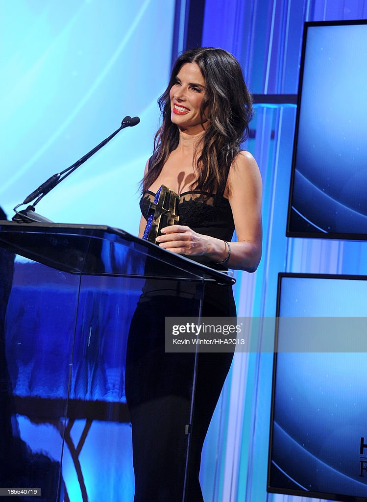 Actress <a gi-track='captionPersonalityLinkClicked' href=/galleries/search?phrase=Sandra+Bullock&family=editorial&specificpeople=202248 ng-click='$event.stopPropagation()'>Sandra Bullock</a> accepts the Hollywood Actress Award for 'Gravity' during the 17th annual Hollywood Film Awards at The Beverly Hilton Hotel on October 21, 2013 in Beverly Hills, California.