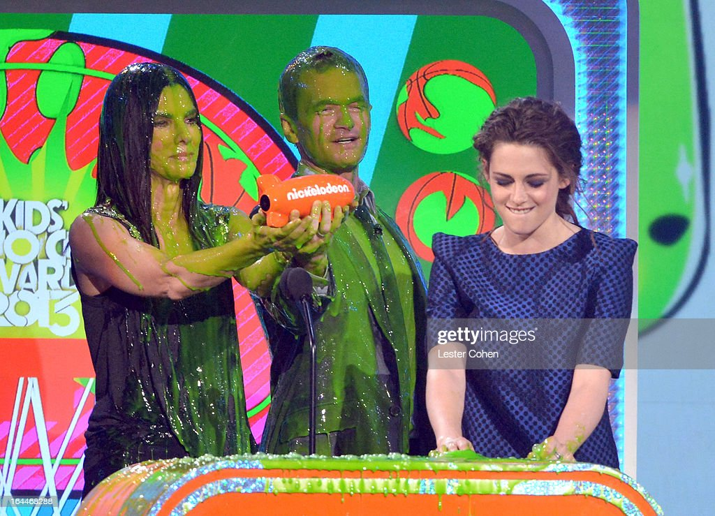 Actress Sandra Bullock, actor Neil Patrick Harris and actress Kristen Stewart perform during Nickelodeon's 26th Annual Kids' Choice Awards at USC Galen Center on March 23, 2013 in Los Angeles, California.