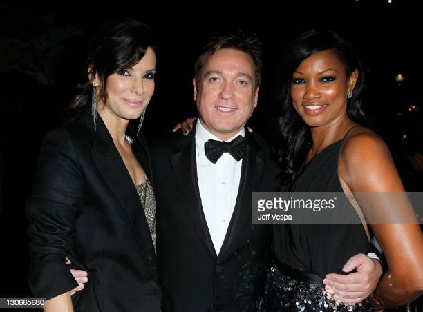 Actress Sandra Bullock agent Kevin Huvane and actress Garcelle Beauvais attend The 2011 amfAR Inspiration Gala Los Angeles held at the Chateau...