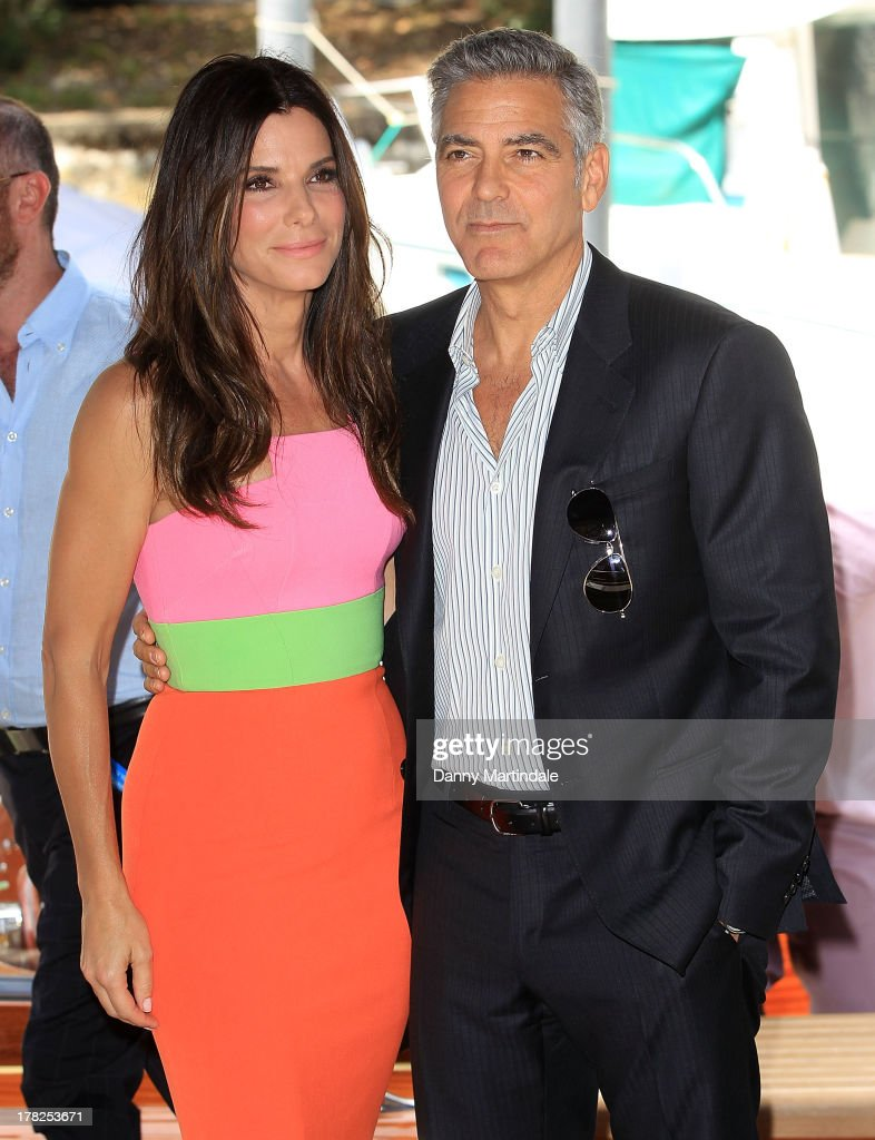 Actress <a gi-track='captionPersonalityLinkClicked' href=/galleries/search?phrase=Sandra+Bullock&family=editorial&specificpeople=202248 ng-click='$event.stopPropagation()'>Sandra Bullock</a> and actor <a gi-track='captionPersonalityLinkClicked' href=/galleries/search?phrase=George+Clooney&family=editorial&specificpeople=202529 ng-click='$event.stopPropagation()'>George Clooney</a> attend day 1 of the 70th Venice International Film Festival on August 28, 2013 in Venice, Italy.