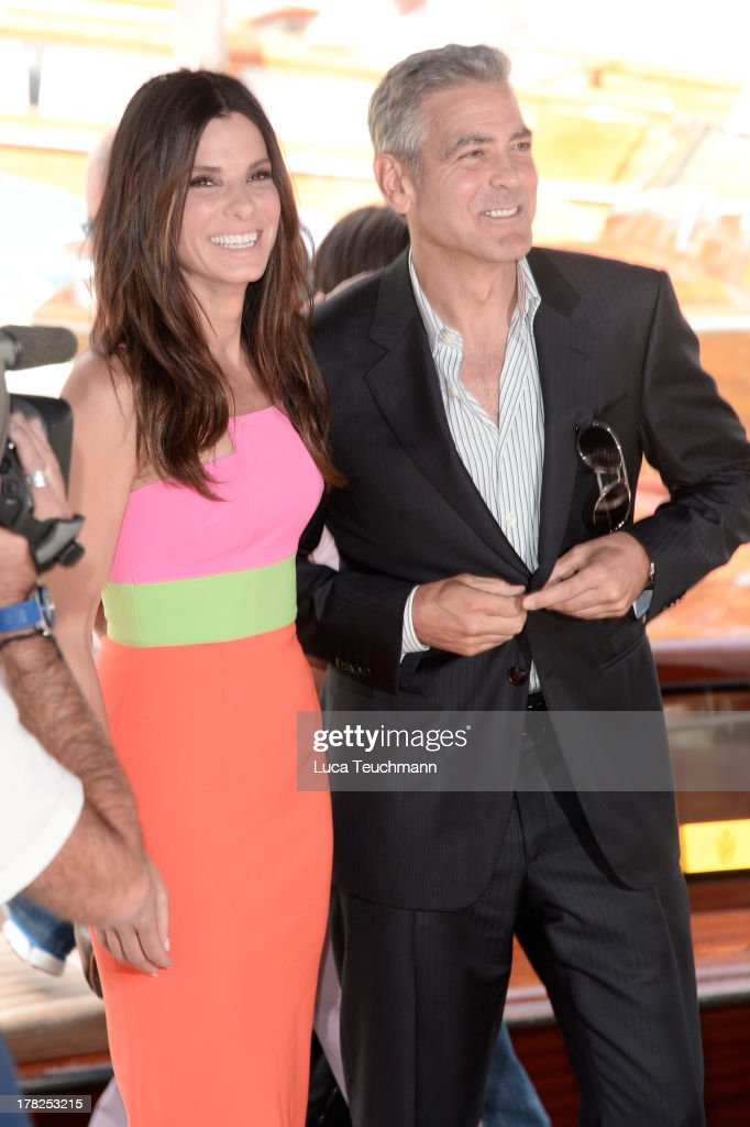 Actress Sandra Bullock and actor George Clooney attend 'Gravity' Photocall during The 70th Venice International Film Festival at Sala Grande on August 28, 2013 in Venice, Italy.