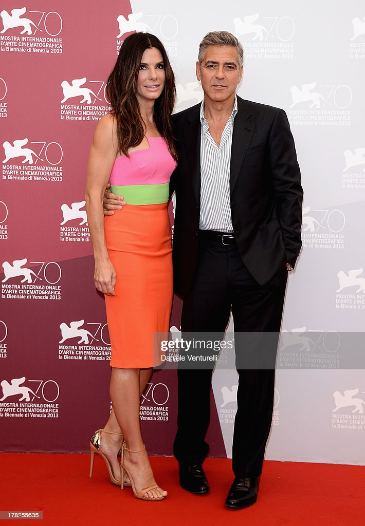 Actress <a gi-track='captionPersonalityLinkClicked' href=/galleries/search?phrase=Sandra+Bullock&family=editorial&specificpeople=202248 ng-click='$event.stopPropagation()'>Sandra Bullock</a> and actor <a gi-track='captionPersonalityLinkClicked' href=/galleries/search?phrase=George+Clooney&family=editorial&specificpeople=202529 ng-click='$event.stopPropagation()'>George Clooney</a> attend 'Gravity' Photocall during the 70th Venice International Film Festival on August 28, 2013 in Venice, Italy.