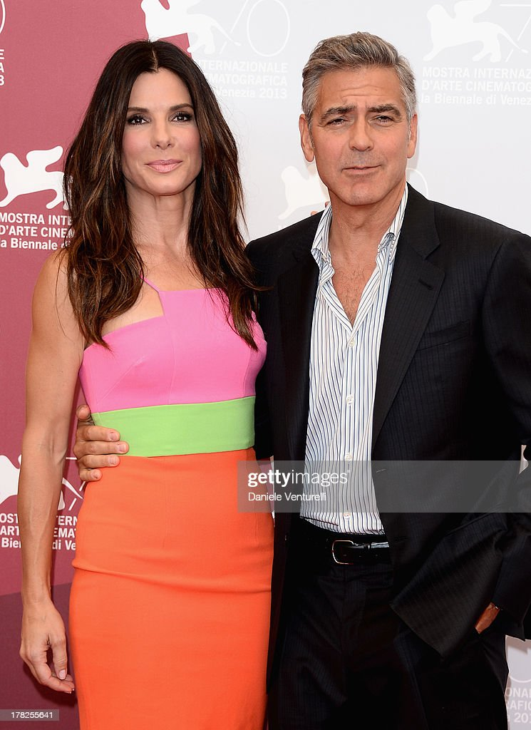 Actress Sandra Bullock and actor George Clooney attend 'Gravity' Photocall during the 70th Venice International Film Festival on August 28, 2013 in Venice, Italy.